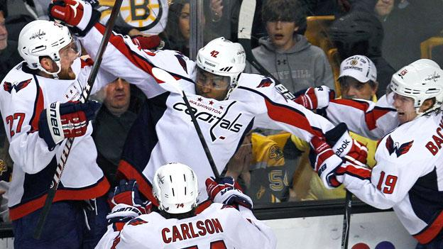 Washington Capitals right wing Joel Ward, center, is congratulated by teammates after his game-winning goal against the Boston Bruins during overtime of Game 7.