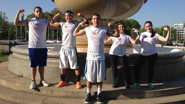 """Five American University students show their support at Saturday morning's DC RUNS FOR BOSTON. The crew, two of whom are Massachusetts natives, sported homemade """"Boston Strong"""" t-shirts."""