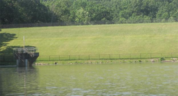 At the Lake Needwood Dam, the yellow line shows how high the water after persistent raining in 2006.