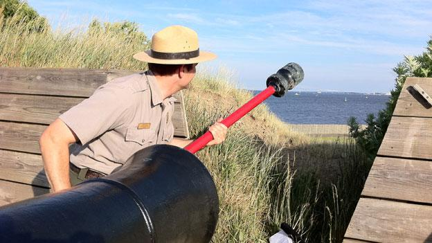 """Park ranger Vince Vaise at the Fort McHenry cannon emplacement in Baltimore. The fort will mark the start of the war of 1812 this weekend with a """"Sailabration."""""""