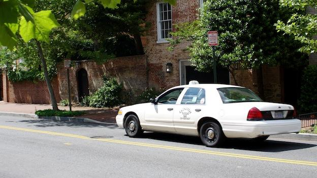 A D.C. taxi cab parks in front of a home on P Street NW, in Georgetown.