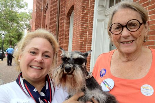 Magee Whelan, left and Hazel Rigby don't let their politics get in the way of their mutual love of schnauzers.