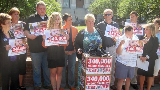 Patty Saylor, center, is joined by the Saylor family and Maryland Democratic gubernatorial candidate Del. Heather Mizeur speaking outside the statehouse.