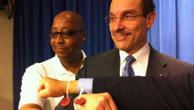 Mayor Gray shows off a police wristband from when he was arrested alongside D.C. voting rights activists in April 2011.