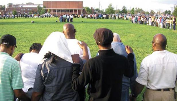 Hundreds of Alexandria residents gather at a vigil after Lenny Harris disappeared in September. Police in Prince George's County, Md. and Alexandria, Va. found Harris's body in a 25-foot-deep well in Ft. Washington, Md. Jan. 26.