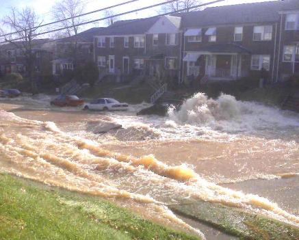 Baltimore water main break floods street near Morgan State University.