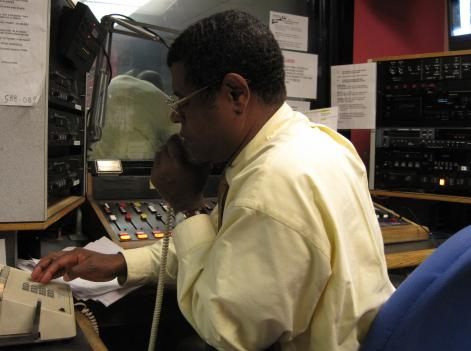 Jean Yves Pont-du-Jour, better known as Yves Dayiti, places a call for his weekly Haitian radio show on local station WPFW. Pont-du-Jour said this was the most important show he had ever hosted.