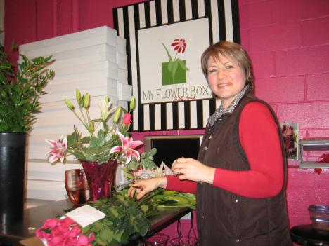 Baltimore floral designer Lana Brown busily fills orders that were delayed because of this week's storm.