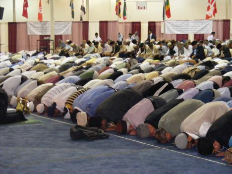 Ahmadi Muslim men pray at the community's annual convention in Chantilly, Va.