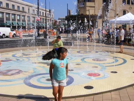 During the weekend heat wave, children in Columbia Heights cooled off in a nearby fountain while ice cream vendors tried to make the most of their melted goods.