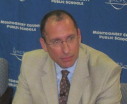 New Montgomery County Schools Superintendent Dr. Joshua Starr (right) speaks to reporters Wednesday.