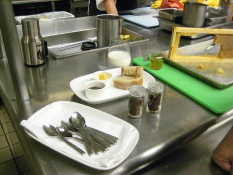 The pepper-tasting spread includes chili paste (in the two jars), fresh-cut honeycomb, bread and cold milk.