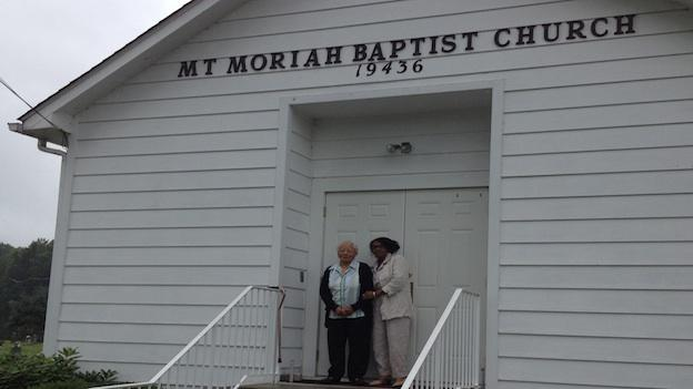 Mary H. Gross (left) and Edith Weedon stand in front of the doors at Mt. Moriah Baptist Church. The church has served many purposes over the years in the small, country town of Pleasant Valley, Md.