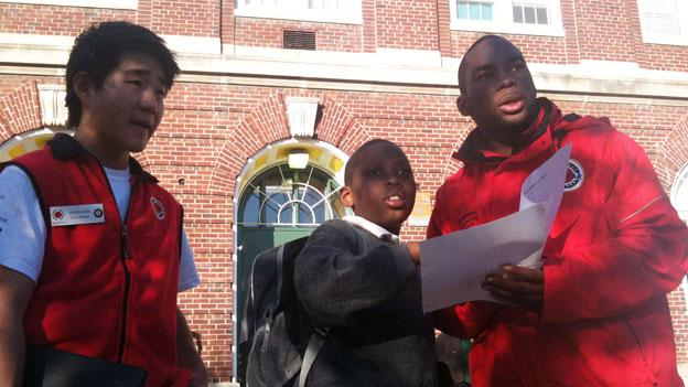 A student checks in with his City Year mentors before school starts at Browne Education Campus in Northeast D.C.